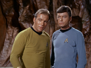 Kirk is allowed to decline but another champion would be chosen. Kirk doesn't think Spock can take the other guy in his condition so Kirk says he'll fight. His plan is to just quit if it looks rough so Spock will win