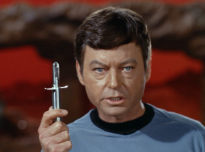 Kirk isn't used to this Vulcan air. Bones says he can give him a shot to give him a fighting chance