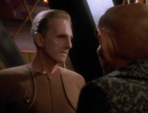 Quark helps Odo. Odo doesn't like this because he can't figure out what Quark is up to. I like the relationship between Quark and Odo
