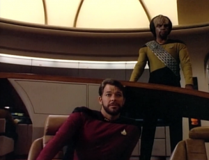 Riker has a beard! Worf in gold! and muscle pads!