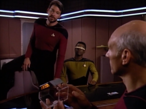 Geordi in gold too! He's the new chief engineer! Also, it's REALLY cool how Riker sits in chairs. He doesn't have time to go around