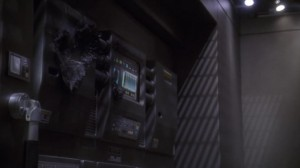 It's cool how Travis went into the shuttle bay and saw a burnt out console, and then went Travis' body is found the burned out console is said to be the cause of his death. What's going on here?
