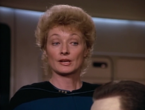 """Pulaski comes to the bridge for no discernible reason other than to talk trash on Data. She refers to him as """"it"""" and a """"non-living device."""""""