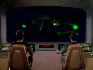 They go into the hole and find a Romulan Warbird