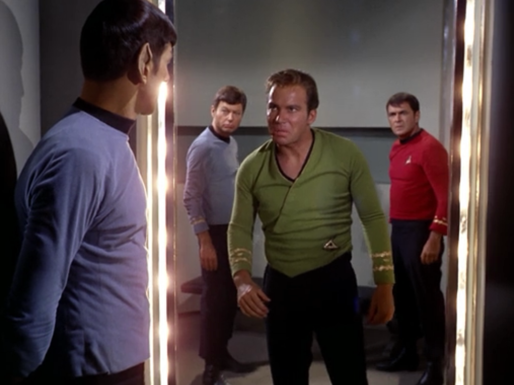 """Meanwhile back in the normal universe, the Mirror-Kirk is sent to jail andd is really confused. Mirror-Kirk: """"Spock, what happened to your beard?"""""""