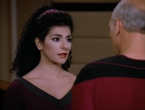 Back when it was just a hole Troi didn't sense any mind, but now that's it's obvious to the viewers that something is messing with them, Troi isn't so sure anymore