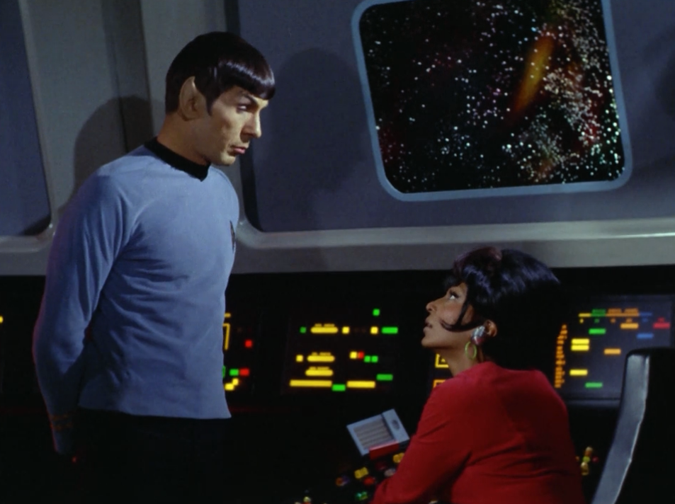 Uhura finds a way of communicating with Kirk. They begin to hatch a plan