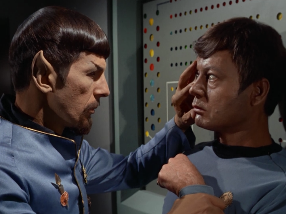 Mirror-Spock doesn't know why people are acting so nice so he mind melds with Bones