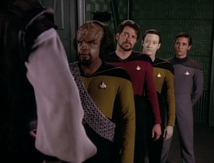 They beam over Okona. Why is everyone hiding behind Worf
