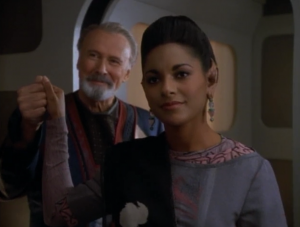 The lady shows up but she's wearing different clothes and is married and doesn't remember Sisko