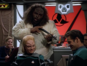 Melora decides not to go with the treatment because she wouldn't be herself anymore, or one of her own people. And a klingon sings, which probably didn't need to happen