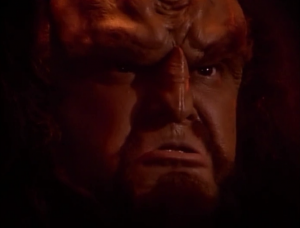 There is an organism eating the Klingon ship and they think it's an attack from the Enterprise