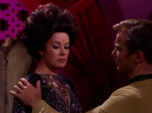 Kirk touches her shoulder