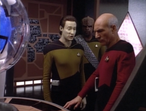Data, Picard and Worf beam to the surface of Iconia and find some kind of control room