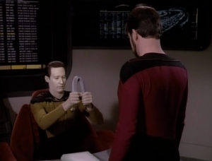Riker nails Data with questions about what he's made of. He also asks him to bend a pipe probably just because he thinks it's cool