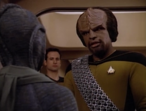Worf and Salia's protector have a verbal face off about being a protector and who would win in a fight. By the end of the episode they earn each other's respect