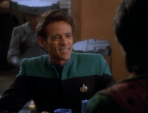 Another plus to having Garak is that it gives Bashir an interesting role to play for a change. Also, the aliens behind Bashir have really dorky hats