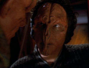 This guy wants to kill Quark. He has a handle on his face