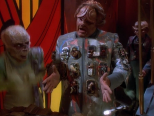 Were they trying to make the ugliest alien possible? Why are there guitar pedals on his jacket?
