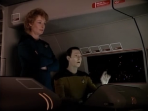 Data and Pulaski do a test out in a shuttlepod because it's isolated from the ship