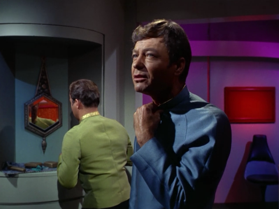 Enterprise is picking up delegates from the various Federation members. Can't Kirk arrange for his mirror to be at his own height?