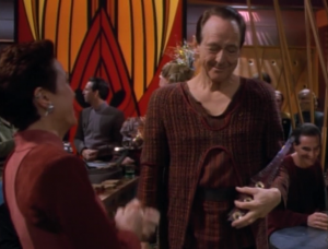 There's a Bajoran musician that appears throughout this episode to play music and give his opinion on things. Thanks Bajoran musician!