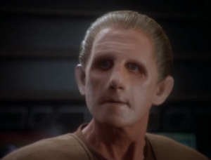 The bajoran scientist figures out that the blob monster is really Odo, and Odo isn't aware of what he's doing. Something on the planet is affecting him.