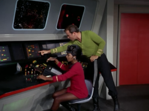 Uhura forgot about the blue rectangle on her control panel. Luckily Kirk points it out to her