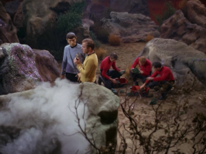 Kirk and Spock check out some tritanium and some smoke sneaks up on them!