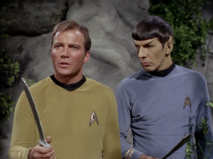 Kirk decides they need to make better weapons. Toy swords aren't good enough