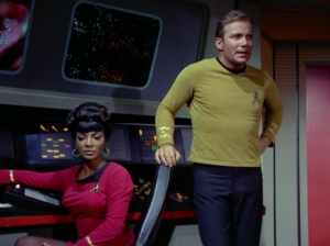 Kirk returns! He tells Uhura to send a code 2 message waring starfleet that's he's going to set of the corbomite, destroying everything in the area.