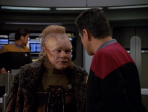 Neelix is being a good delta quadrant guide. He even wears cooler clothes in this one.