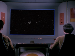 Kirk tricks the alien ship and disables it. Then is self-destructs