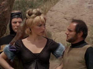 The lady goes out and says she killed them while they were asleep. The Klingon wants to go check