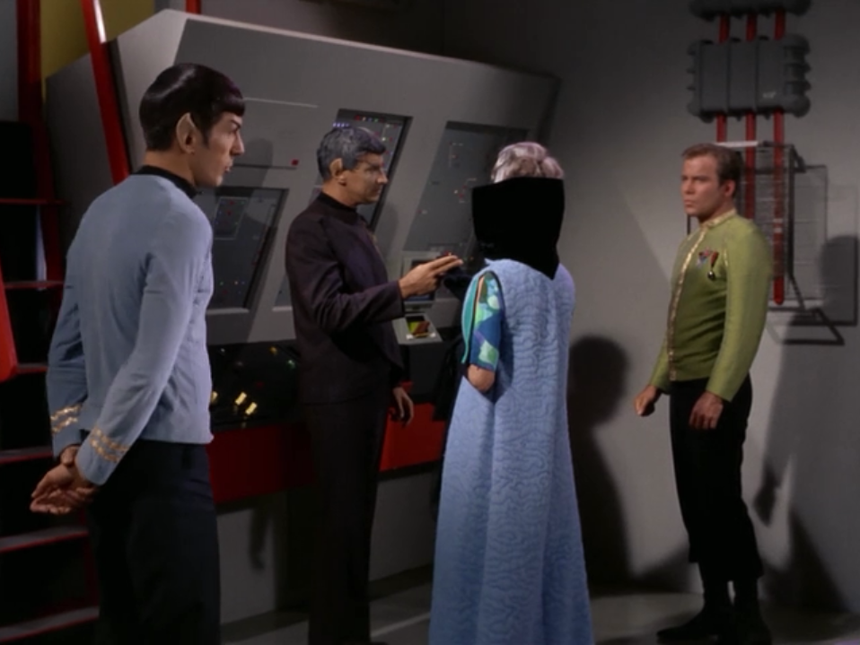We find out that the Vulcan ambassador is Spock's father, Sarek. Sarek wanted someone other than Spock to give the tour. Kirk still asks Spock to hang around and explain things to them so we're again reminded that there's tension between them