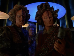 So they beam over some Kazon guys and negotiate for Chakotay