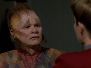 Neelix asks a bunch of questions he should already know the answer to in a lame scene of exposition