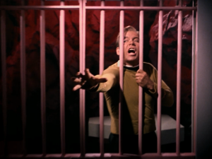 We hear Uhura scream and Kirk looks like he's gonna kill someone. This seems like one of the darkerst scenes in Star Trek, but is followed by a comic scene. Lars just leaves Uhura's cell and says she's not allowed to resist. I'm guessing nothing actually happened to Uhura...right?