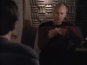 Meanwhile Picard and Wesley are on their way to a station. They eat sandwiches