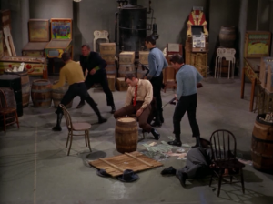 Kirk goes through this whole charade of teaching these guys a new card game just to distract them by dropping a card and punching them all out