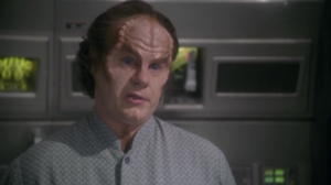 Phlox warns them that they still have ten minutes of show left so they can't beam up the alien because of some condition he has. Trip decides he'll wait with his friend until they figure something out