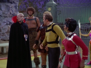 Uhura is told to beat up a guy that's tied up. Uhura refuses, and as punishment she has to be tied up and attacked. But then Kirk steps in and takes Uhura's place. Look, will someone please just get tied up and beaten already