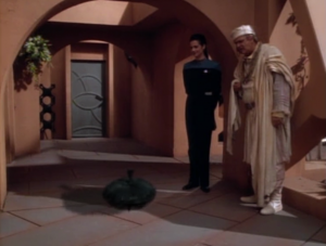 They fix the town and before they leave Odo trns into a top for the girl. Aww, that means they're friends