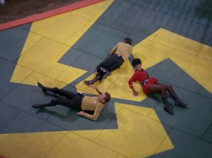 Kirk, Chekov and Uhura are magically brought to some planet. The planets probably called Triskelion