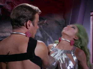 Kirk kisses Shahna and then does some kind of mini punch, which of course instantly knocks her out, and allows for Kirk's escape. This episode is great