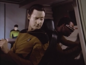 Data and Geordi fix the shuttle and find out it's from 6 hours in the future