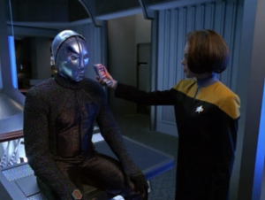 After ten minutes of technobabble they get it running. B'Elanna, it's rude to hold a tricorder right up to someone's face.