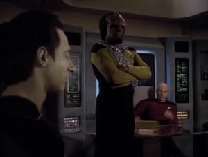 How come Worf isn't sitting down