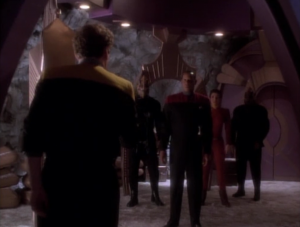 He goes to a moon and finds Sisko and Kira and some aliens