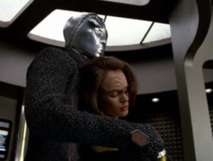 The robot steals B'Elanna and beams over to his ship.